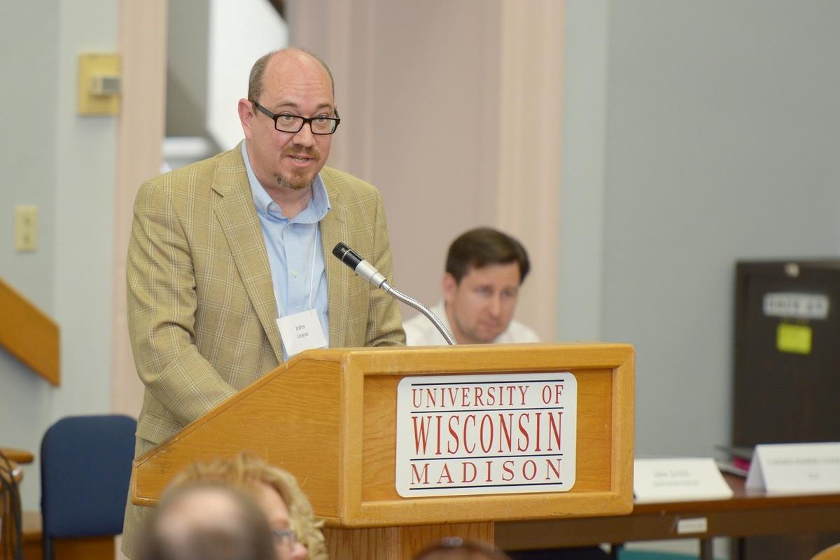 Photo: John Lease speaking at podium