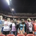 Photo: Students singing 'Varsity' in Kohl Center