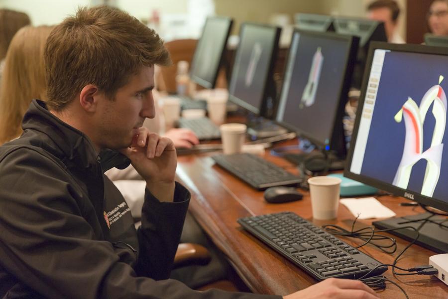 Photo: Medical resident looking at simulator screen