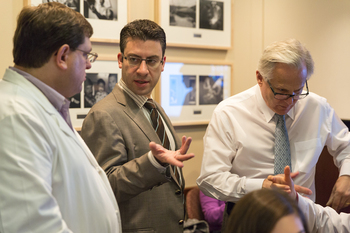 Photo: Eftychios Sifakis, center, talks with Tim King, left, and Court Cutting during a training session for surgical residents.