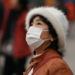 Photo: Woman in China wearing breathing mask