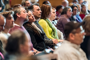 Photo: Audience members listening
